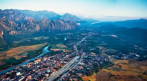 Aerial view of a small town in rocky mountain valley and river Stock Photos