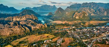 Aerial view of a small town in rocky mountain valley and river Royalty Free Stock Images