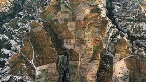 Aerial view of small vegetable fields between the craggy cliffs. Of Cappadocia, Anatolia, Turkey, from the hot air balloon royalty free stock photos