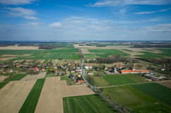 Aerial view of the small village. And the large green field Stock Photography