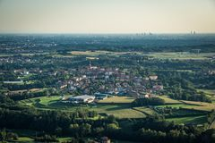 Aerial view of a small village in lombardy with milan skyline royalty free stock photos