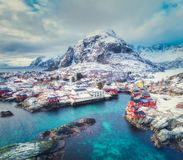 Aerial view of small village on the mountain in winter. Aerial view of small village at sunset in winter. Top view of Lofoten islands, Norway. Landscape with royalty free stock photos