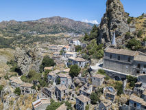 Aerial view of the Small village of Pentedattilo, church and ruins of the abandoned village, Greek colony on Mount Calvario, whose. Form recalls the five royalty free stock photos