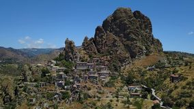 Aerial view of the Small village of Pentedattilo, church and ruins of the abandoned village, Greek colony on Mount Calvario stock video