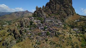 Aerial view of the Small village of Pentedattilo, church and ruins of the abandoned village, Greek colony on Mount Calvario, whose stock footage