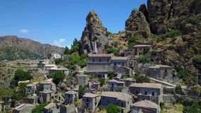 Aerial view of the Small village of Pentedattilo, church and ruins of the abandoned village, Greek colony on Mount Calvario, whose stock video footage