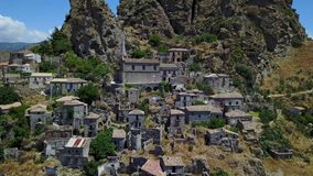 Aerial view of the Small village of Pentedattilo, church and ruins of the abandoned village, Greek colony on Mount Calvario stock footage