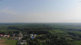 Aerial view of small village in Trang Thailand with rich environment. Aerial view and moving toward with small village scene and nature in rich environment at stock video