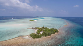 Aerial view on small wonderful island in Indian ocean, Maldives Royalty Free Stock Image