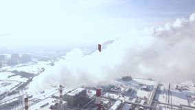 Aerial view smoke clouds from boiler pipes on industrial area. Smoking chimney on chemical plant industrial city drone stock video