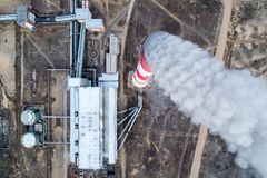 Aerial view smokestack. Pipe energy plant factory Royalty Free Stock Image