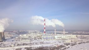 Aerial view smoking chimney on power plant on city landscape. Smoke emission from boiler pipe on thermal plant in modern. Aerial view smoking chimney on power stock video