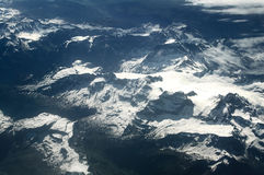 Aerial view of the snow Alps mountains. Europe. Royalty Free Stock Image