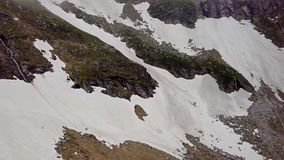 Aerial view of the snow-capped highlands of the Alps stock footage