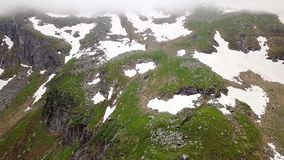 Aerial view of the snow-capped highlands of the Alps. Austria stock footage
