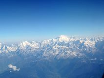 Aerial view of snow-clad Himalayas. Aerial view of snow-clad Himalayan ranges and Mount Everest, the highest peak in the Himalayas Royalty Free Stock Photography