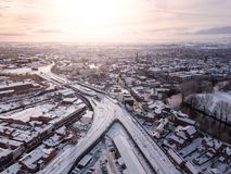 Aerial view of snow compromised rail and road networks.
