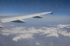 Aerial view of snow covered alps through airplane, France Royalty Free Stock Photos