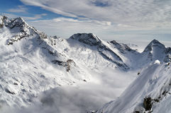 Aerial view of snow covered alps mountain in winter Royalty Free Stock Photo