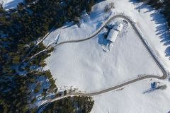 Aerial view of snow covered cottages in alpine area royalty free stock photo