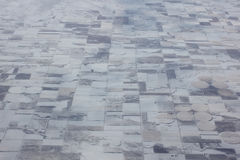 Aerial view snow covered farmland Stock Photos
