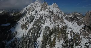 Aerial view of snow covered mountain ridge. stock footage