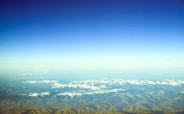 Aerial view of snow covered mountains Royalty Free Stock Photo