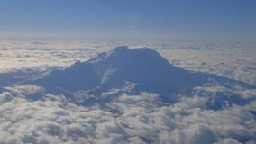 Aerial view of snow covered Mt. Rainier stock images