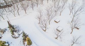 Aerial view of snow covered picnic tables Royalty Free Stock Photography