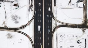 Aerial view snow-covered road with cars in winter Stock Photo