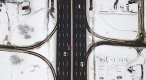 Aerial view snow-covered road with cars in winter Stock Photos