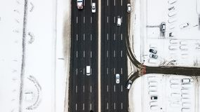 Aerial view snow-covered road with cars in winter Stock Images