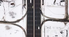Aerial view snow-covered road with cars in winter Royalty Free Stock Photography