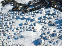 Aerial view of snow covered roofs over the traditional chalets stock image