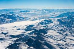 Aerial view snow mountain. Aerial view of snow mountain range Stock Image