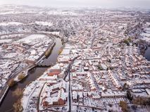 Aerial view of snowed in traditional housing suburbs in England. Stock Photos