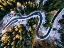 Aerial view of snowy forest with a road. Captured from above with a drone. Dolomites - Italy Royalty Free Stock Photo