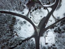 Aerial view snowy forest and road Winter landscape Royalty Free Stock Photos