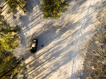 Aerial view of snowy forest in sunny winter day Stock Photography
