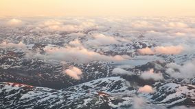 Aerial view of snowy landscape in summer with mountains in Norway. Norwegian mountains stock video footage