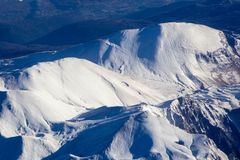 Aerial view of a snowy mountain Royalty Free Stock Images
