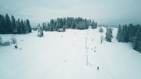 Aerial view of a snowy ski resort in winter. Aerial view of a snowy ski resort Royalty Free Stock Photos