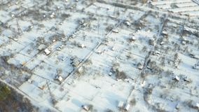 Aerial view of snowy suburb. Tilt shift miniature stock video