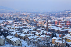 Aerial view on snowy town. Alba, Italy. Stock Photos