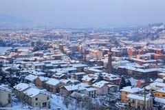 Aerial view on snowy town. Alba, Italy. Stock Photos
