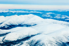 Aerial view of snowy winter mountains Yukon Canada Royalty Free Stock Photo