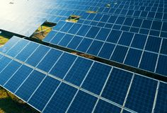 Aerial view of Solar Panels Farm solar cell with sunlight. Drone flight over solar panels field, renewable green alternative royalty free stock image