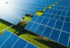 Aerial view of Solar Panels Farm solar cell with sunlight. Drone flight over solar panels field, renewable green alternative royalty free stock photos