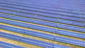 Aerial view of Solar Panels Farm solar cell with sunlight. Drone flight fly over solar panels field renewable green. Alternative energy concept stock video footage
