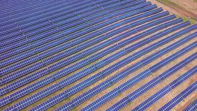 Aerial view of Solar Panels Farm, solar cell, with sunlight.Drone flight fly over solar panels field renewable green. Alternative energy concept stock footage